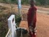 MORAWEWA-LADY-COLLECTING-WATER