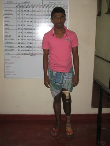 CENTRE FOR HANDICAPPED TEENAGE BOY WITH NEW LIMB