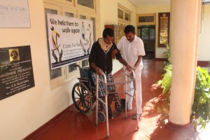 CENTRE FOR HANDICAPPED MR PRASANA WITH WALKING DEVICE